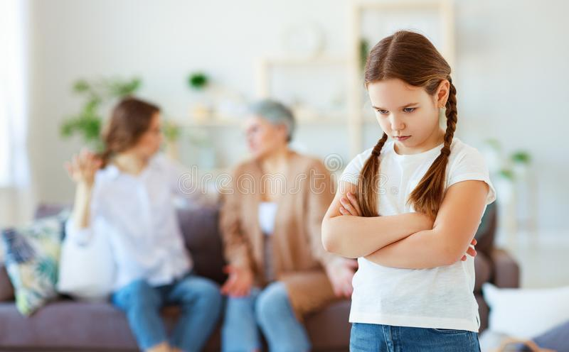 Conflict of family three generations angry mother and grandmother scolding  naughty child. Conflict of  family three generations angry mother and grandmother royalty free stock image