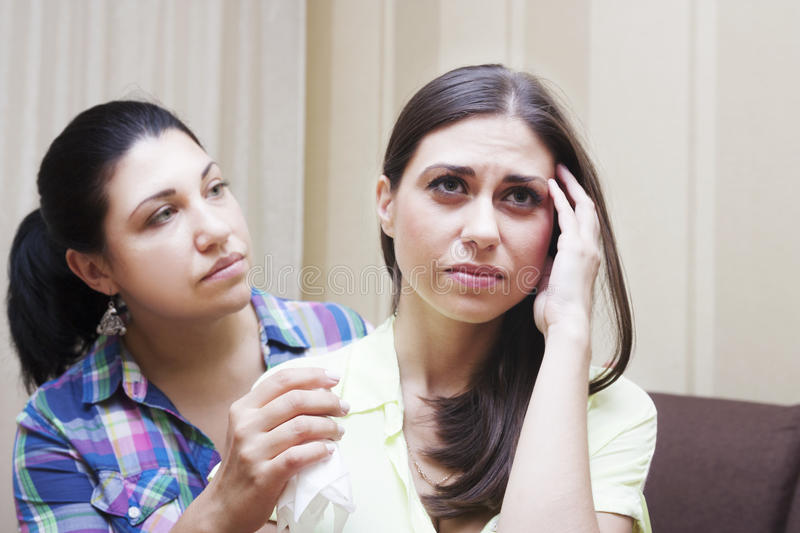 Conflict among friends. A women give solace her friend royalty free stock image