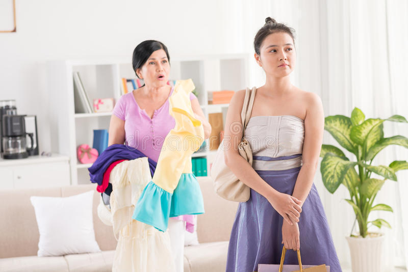Conflict between mum and daughter. Image of an irritated mum conflicting with her teenage daughter at home stock photos