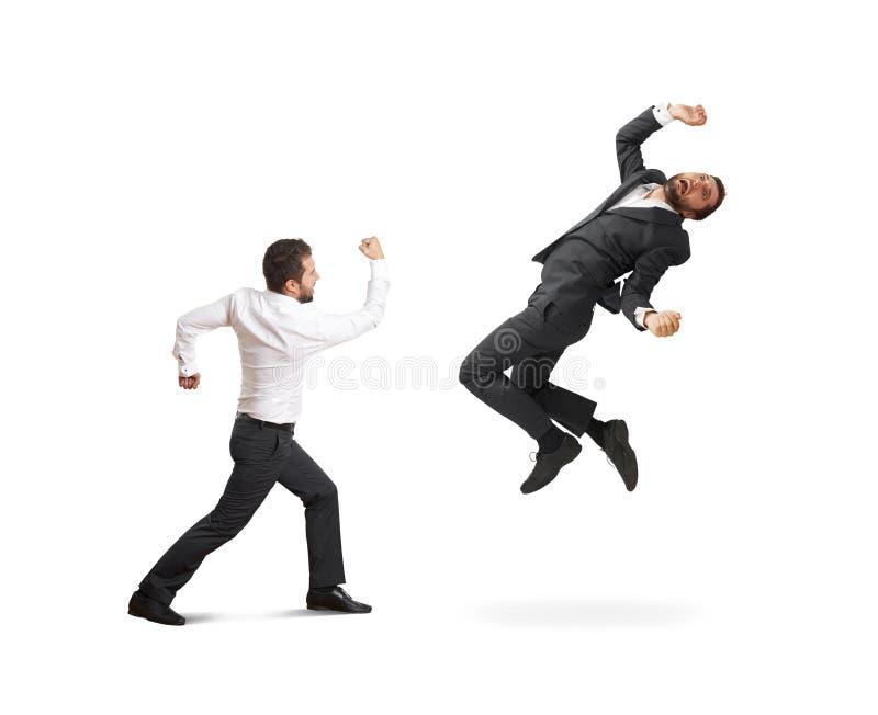 Conflict tussen twee zakenlieden royalty-vrije stock afbeelding