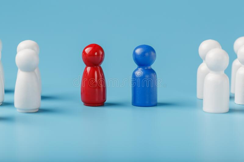 The conflict between two companies and a business, the rivalry of Leaders in blue and red leads a group of white employees to. Compete, Staff recruitment. A lot royalty free stock photography