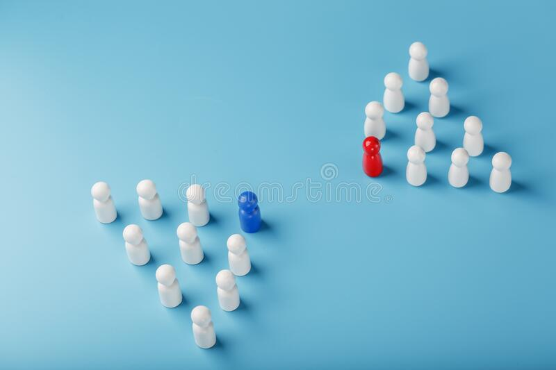 The conflict between two companies and a business, the rivalry of Leaders in blue and red leads a group of white. Employees to compete, Staff recruitment. A lot stock photos
