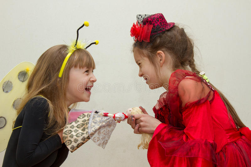 The conflict between two sisters. the kids are fighting, fight over for toy stock image
