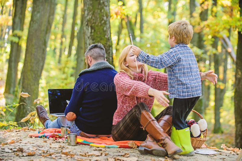 Conflicts of being dad. Family and career goals. Dad is always busy. Family day concept. Family with kid boy relaxing in royalty free stock images