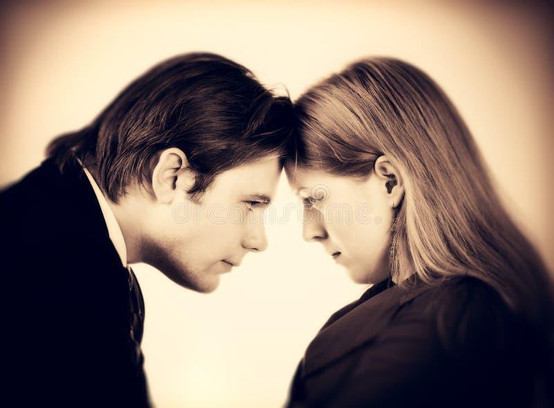 Conflit d'homme et de femme photo stock