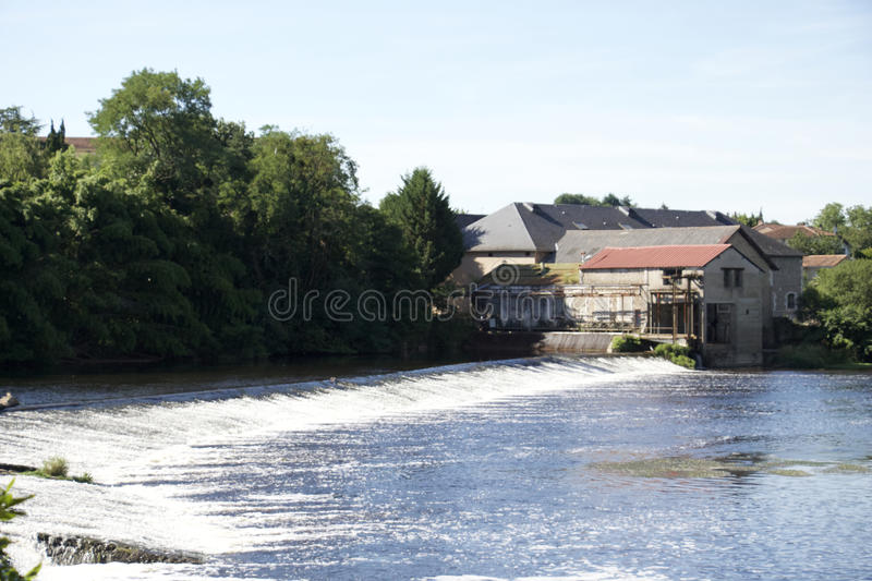 Confolens - France - A old hydroelectric power dam royalty free stock image