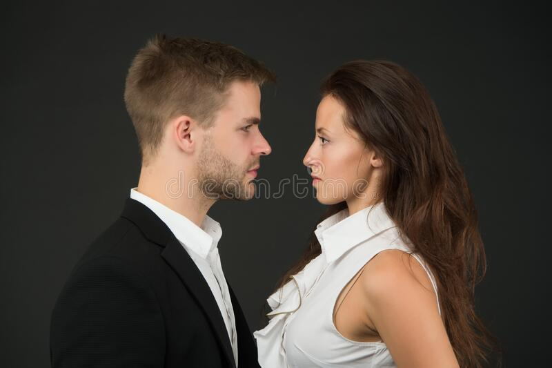 Confrontation. Business couple. Business team. Partnership concept. Office fashion and corporate attire. Businessman ceo. Businesswoman and employee. Business royalty free stock photography