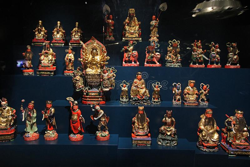 Confucian art. Many chinese confucian statues inside the modern confluence museum at lyon in france stock image