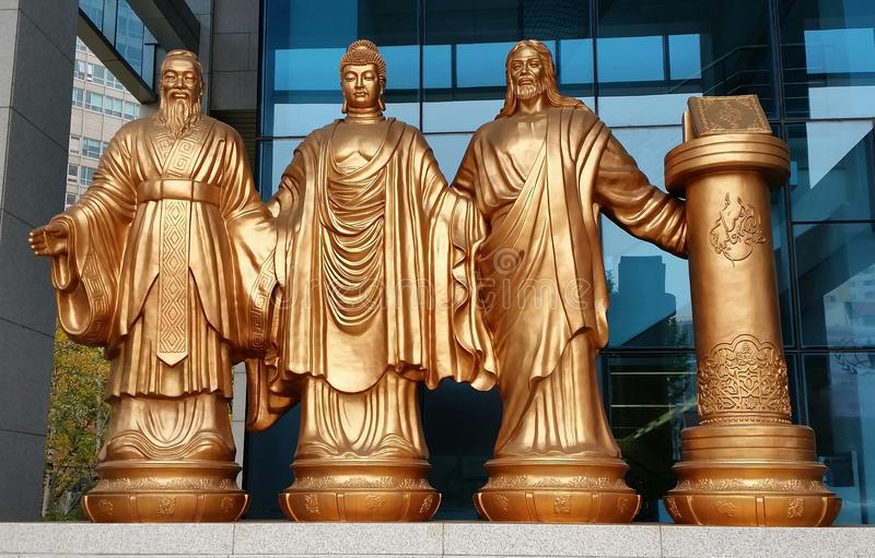 Confucius, Buddha, Jesus, Quran. Religions Together in One Place stock image