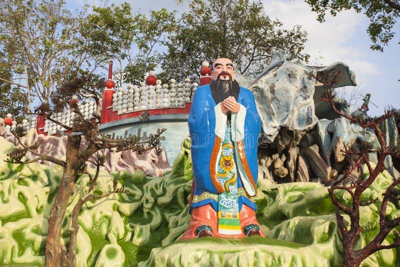 Confucius Statue at Haw Par Villa. SINGAPORE - FEBRUARY 1, 2014: Chinese Scholar and Teacher Confucius Statue Diorama at Haw Par Villa Theme Park. This theme stock photos