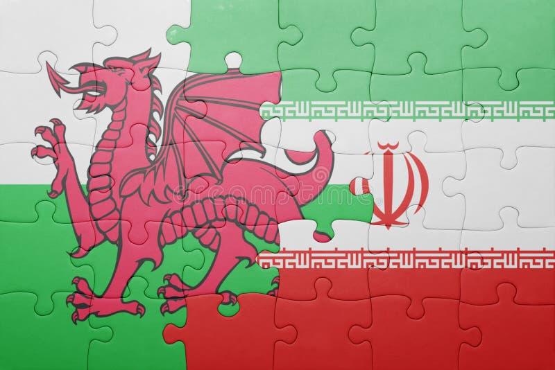 confunda com a bandeira nacional de wales e de Irã fotos de stock