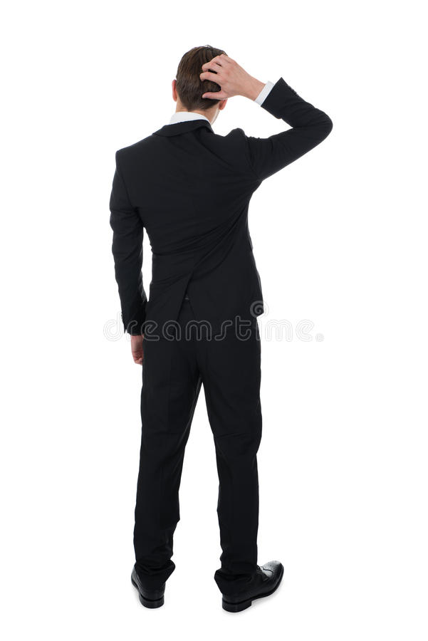 Confused бизнесмен царапая его голову стоковая фотография rf