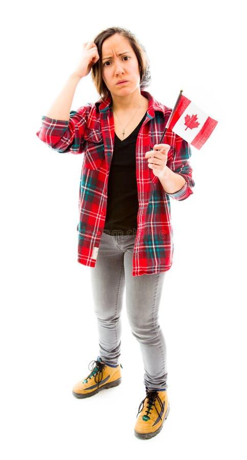 Download Confused женщина с держать флаг Канады Стоковое Изображение - изображение насчитывающей случай, канадско: 41652179