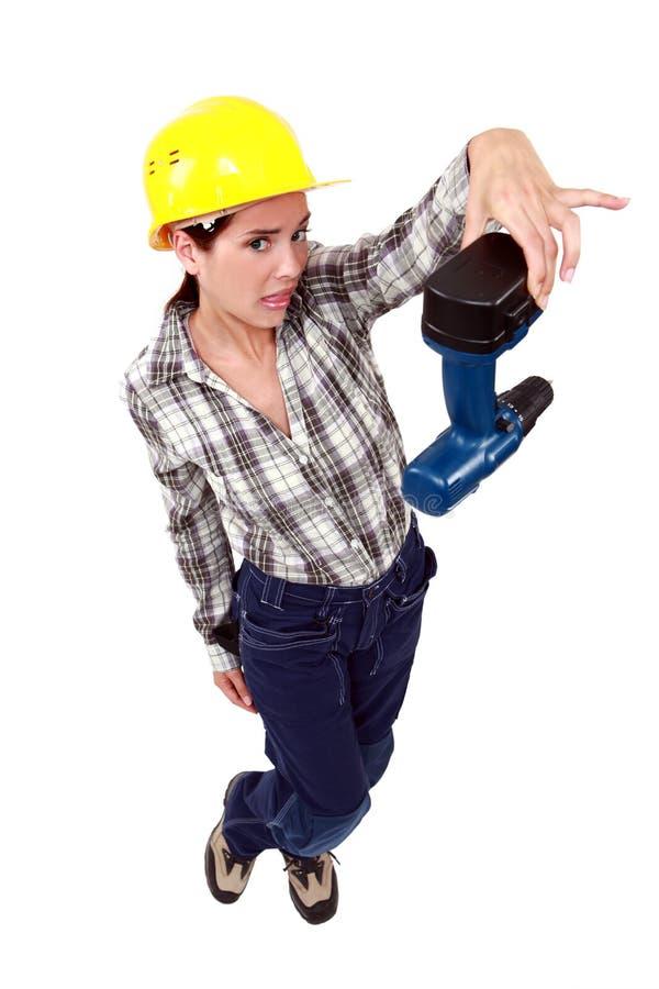 Confused женщина с сверлом стоковая фотография rf