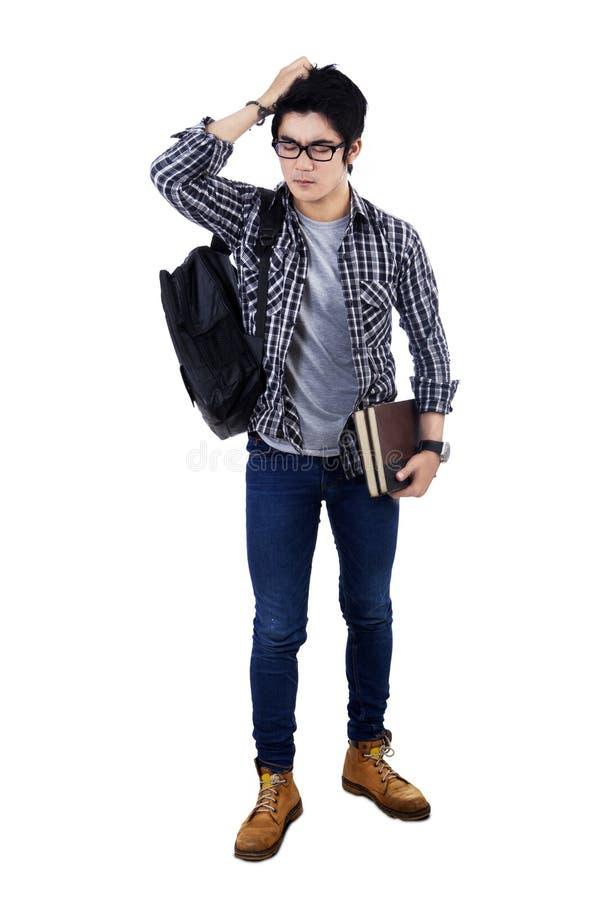 Confused студент думая идея стоковое фото rf