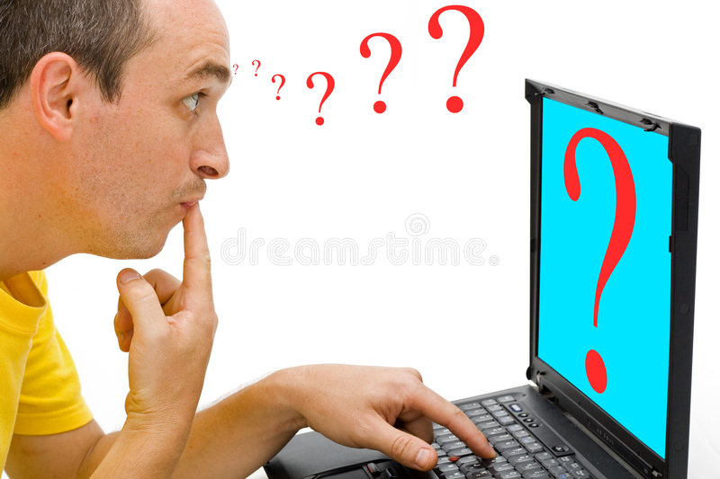Confused. A man looking confused to the PC stock photos