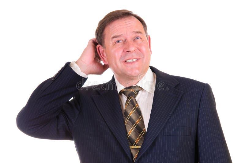 Confused affärsman med gest royaltyfri fotografi