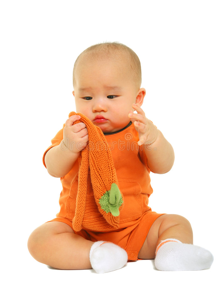 Confused Baby Take Off Hat Stock Images