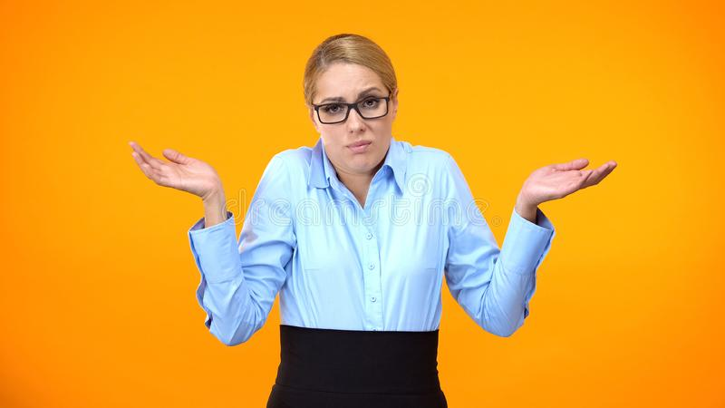 Confused business lady throwing up hands, having no idea, lack of inspiration stock photos