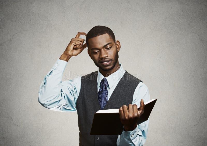 Black man reading final