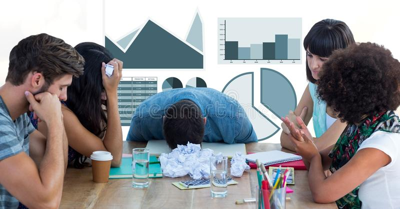 Confused business people with paper balls against graphs stock photo