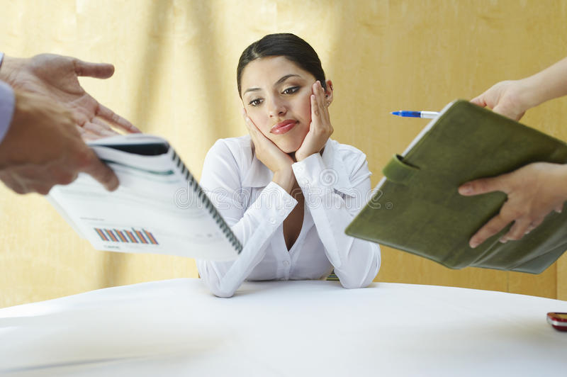 Confused Business Woman With Colleagues stock images