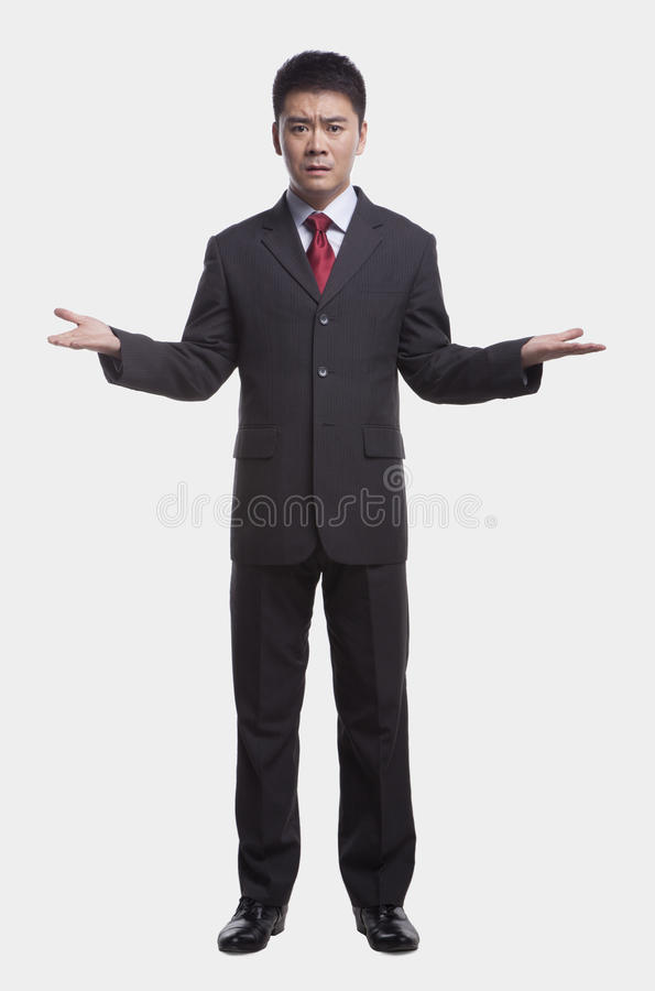 Download Confused Businessman With Arms Out To The Side And Palms Up, Full Length Studio Shot Stock Photo - Image: 31107092