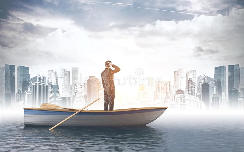 Confused businessman in boat looking at city stock image