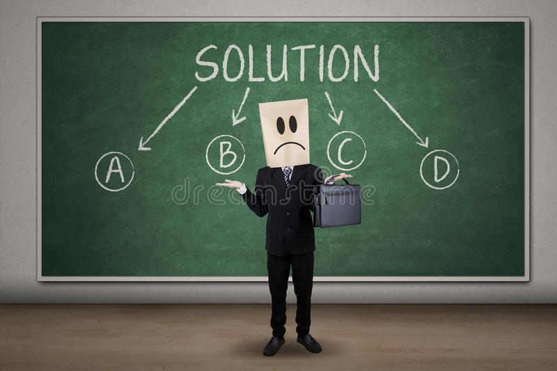 Confused businessman finding solution royalty free stock images