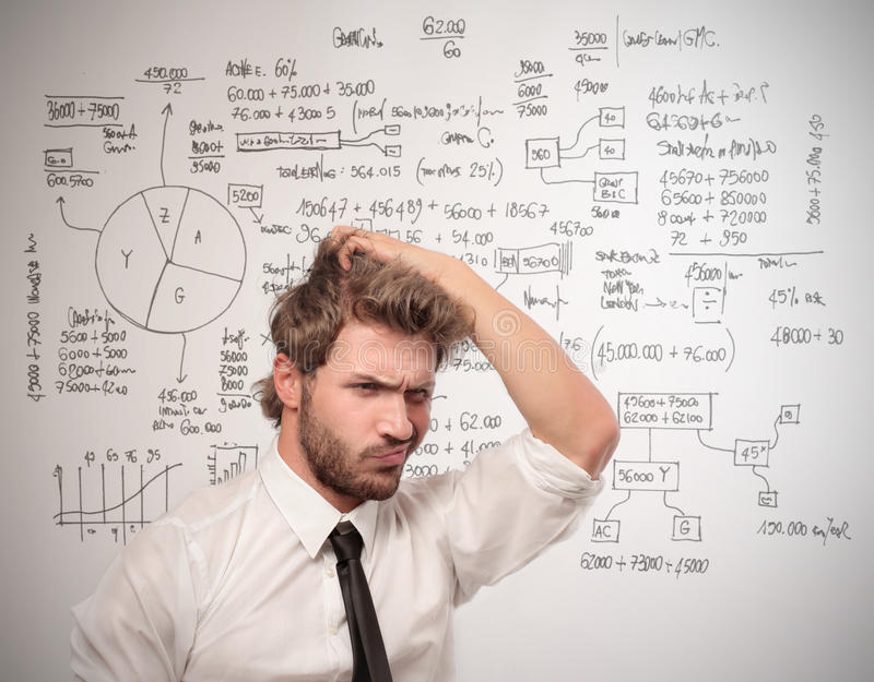 Difficulty. Confused businessman with hand in hair royalty free stock photo
