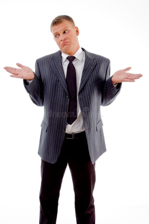 Confused businessman looking aside