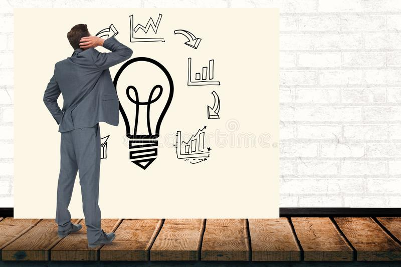 Confused businessman looking at light bulb amidst various graphs on billboard in office. Digital composite of Confused businessman looking at light bulb amidst royalty free illustration