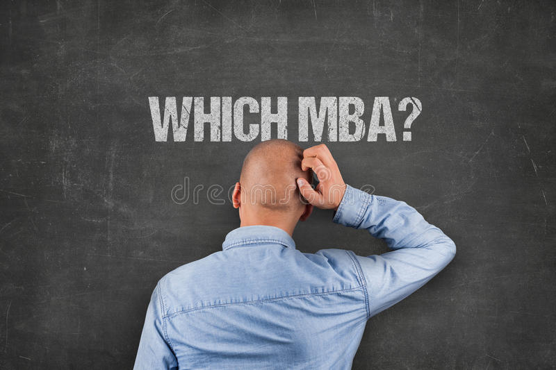Confused Businessman Scratching Head Under MBA Text On Blackboard. Rear view of confused businessman scratching head under which MBA text on blackboard stock image