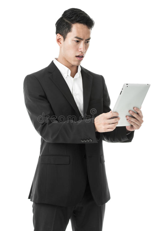 Confused Businessman using Tablet royalty free stock photography