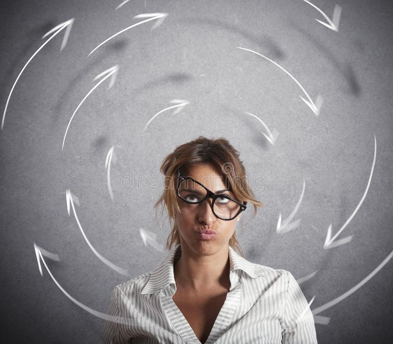 Confused businesswoman has dizziness. Concept of stress and overwork royalty free stock photography