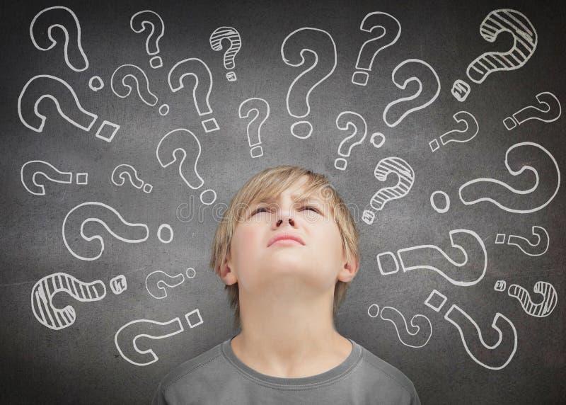 Confused child thinking stock image