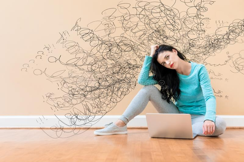 Confused concept with woman using a laptop royalty free stock photography