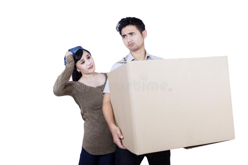 Download Confused Couple Bring Box - Isolated Stock Photo - Image: 32118146