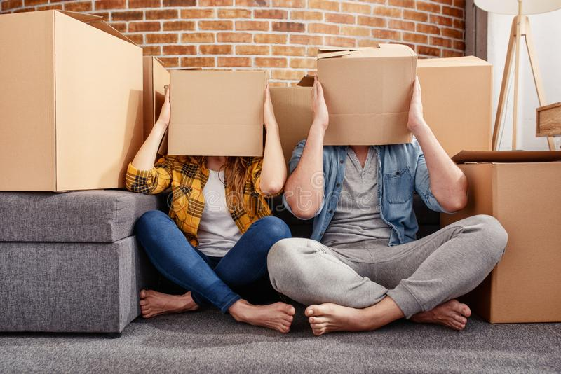Confused couple of having to move and arrange all the packages. Concept of success, delusion, change and future royalty free stock photos