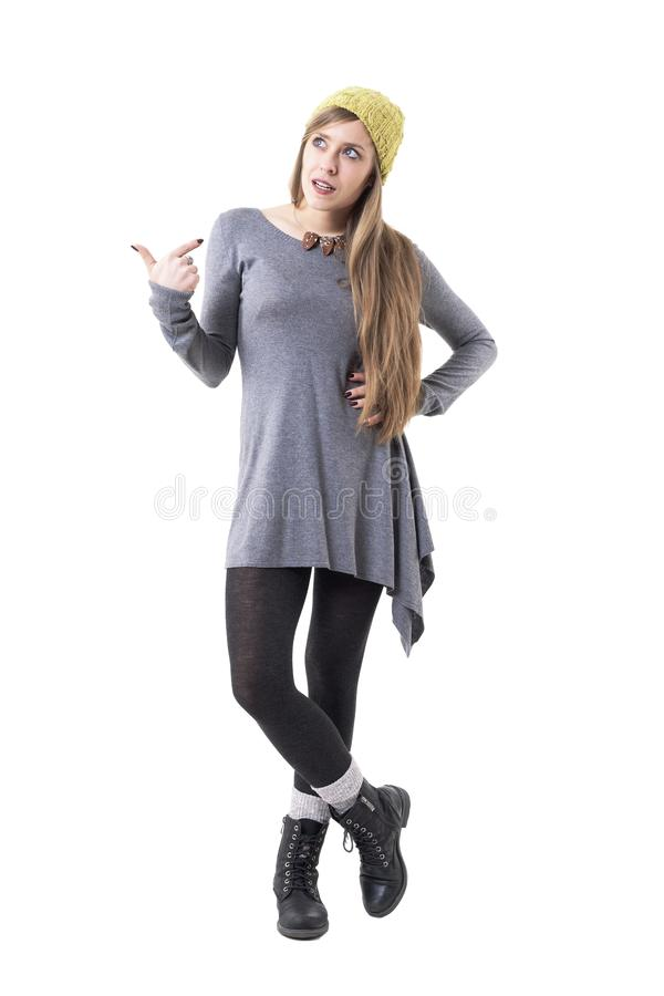Confused displeased young woman pointing at self in conflict situation stock photo
