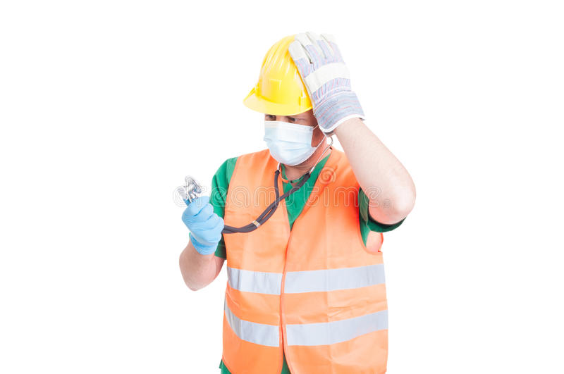 Confused doctor or medic wearing builder clothes royalty free stock photography