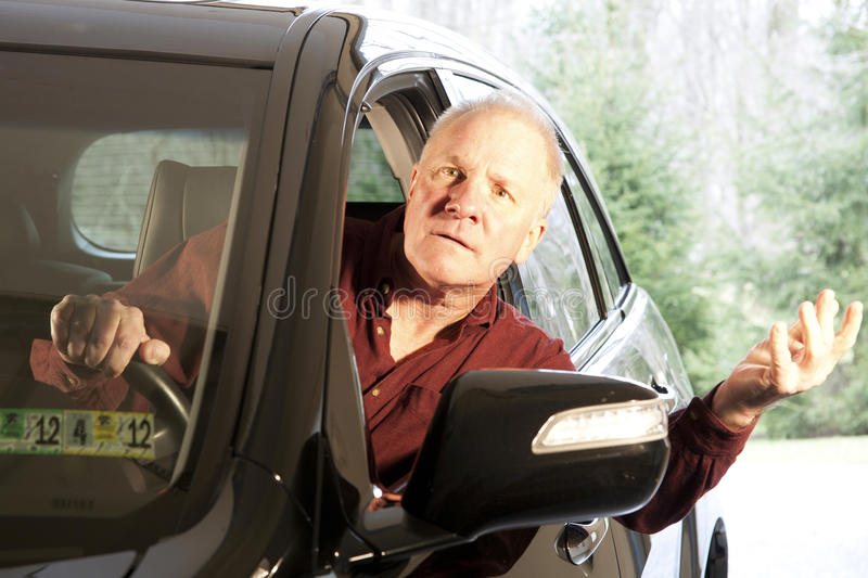 Confused Driver. Driver leaning out window of SUV with a confused look on his face stock images