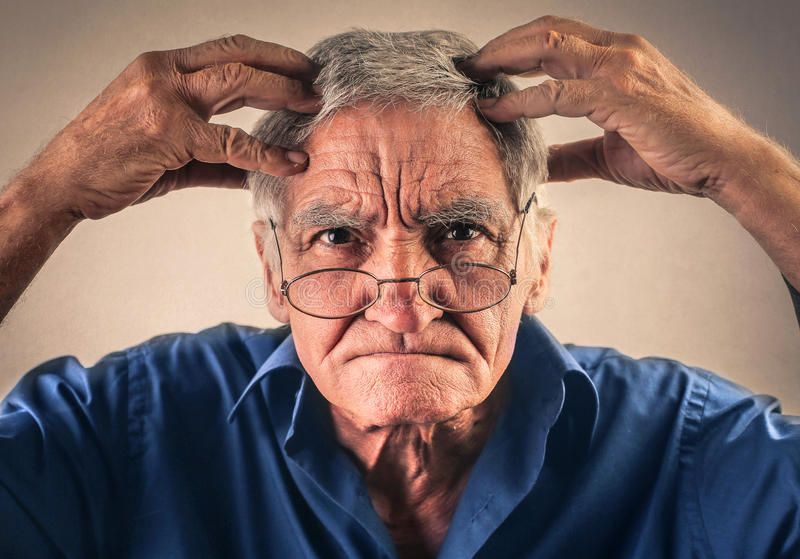 Confused elderly man stock images