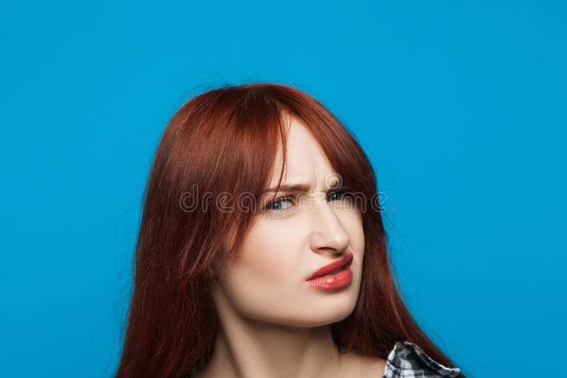 Confused girl portrait. Distrustful woman stock photo