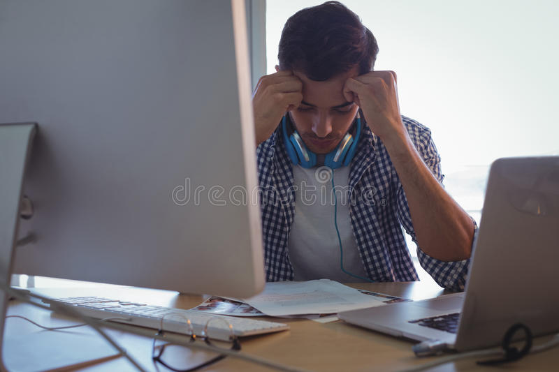 Confused graphic designer sitting in office stock images