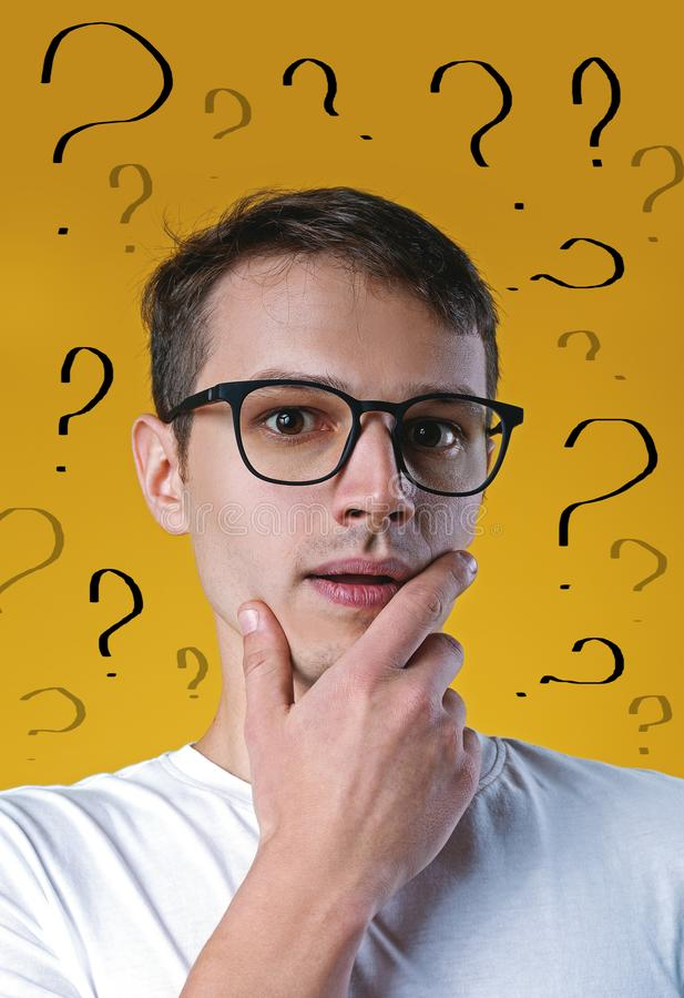 Confused handsome man has too many questions and no answer. Thoughtful confused handsome man has too many questions and no answer royalty free stock photography