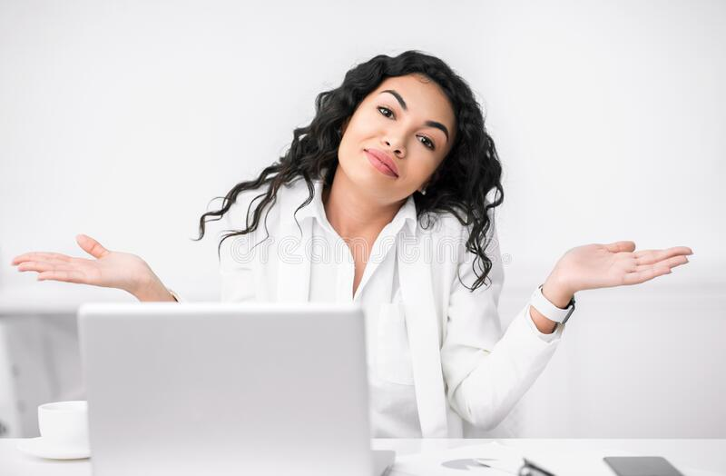 Confused hispanic girl shrugging looking at camera stock photos