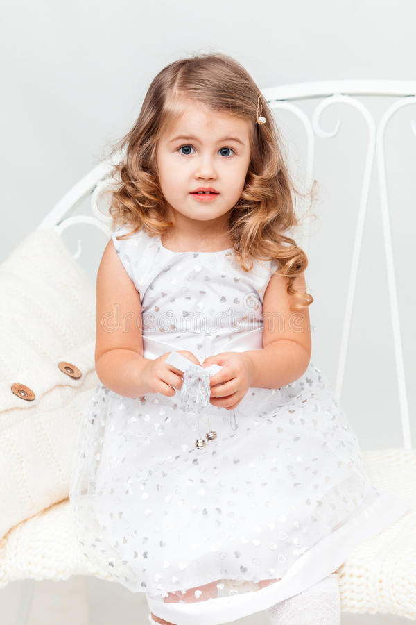 Confused Little Girl In White Stock Photo Image 66481100