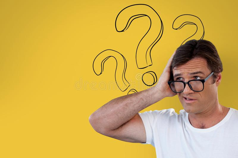 Confused man with glasses holding his head on yellow background with question marks royalty free illustration