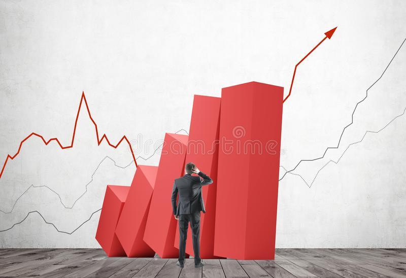 Confused man looking at growing graph royalty free stock photo